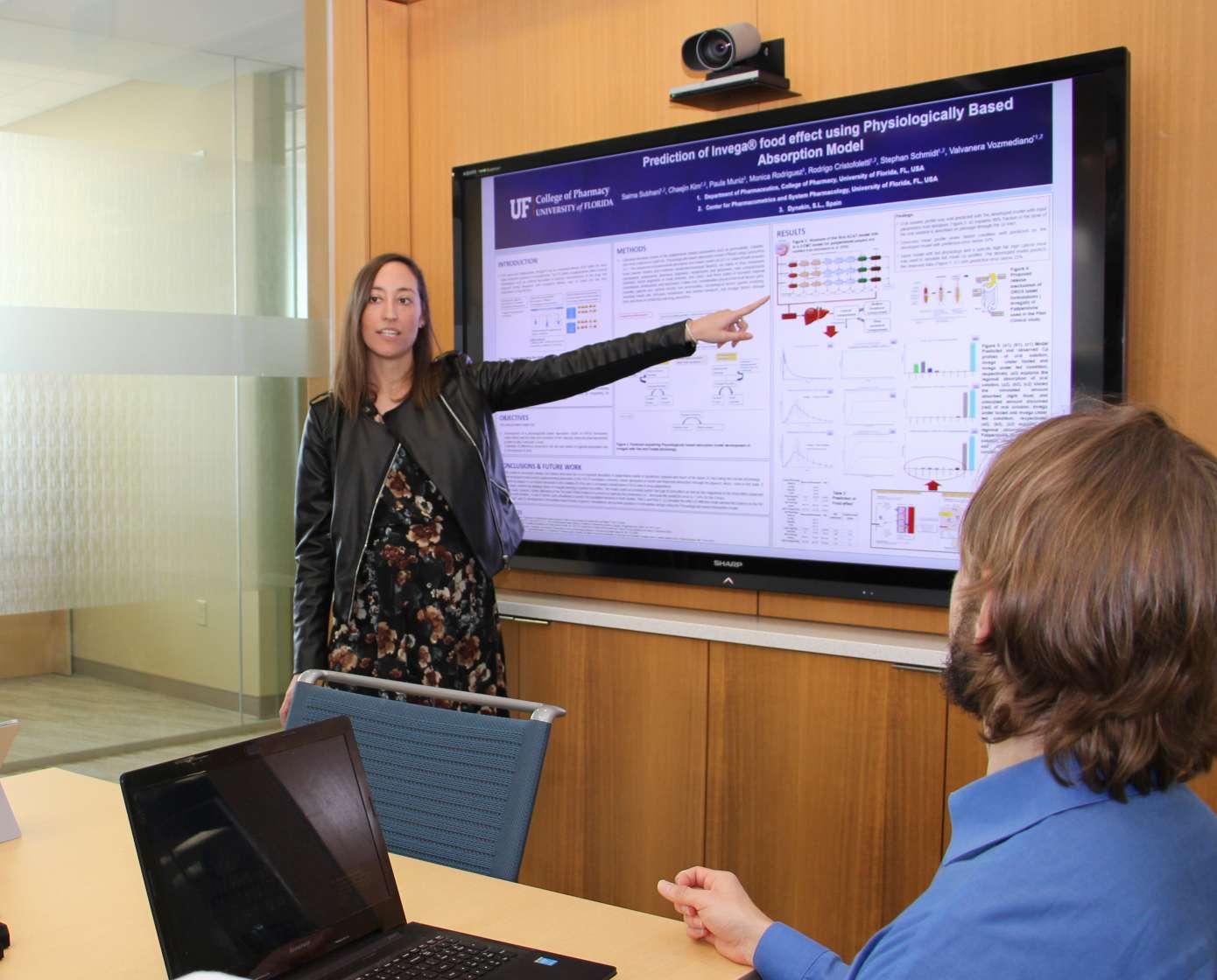 Dr. Valva Vozemediano presents data to her class.