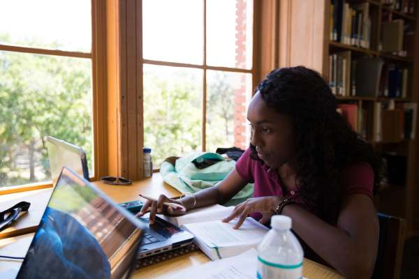 Student studying at smothers library